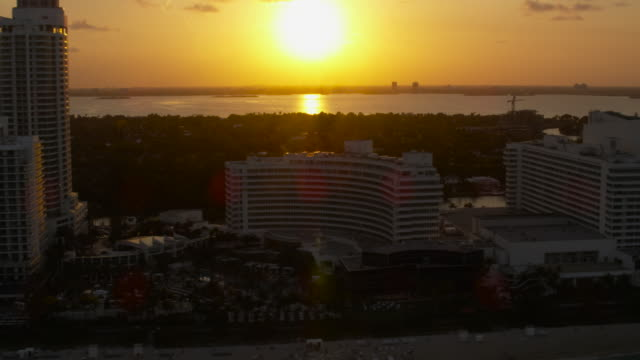 Aerial of buildings and hotels South Beach sunset Miami, FL