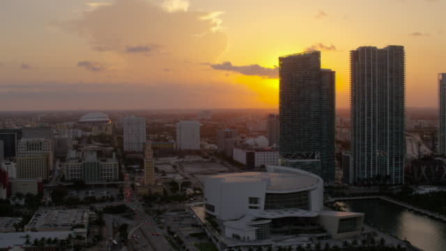 aerial of buildings in downtown miami at sunset fl - miami dade county stock videos & royalty-free footage
