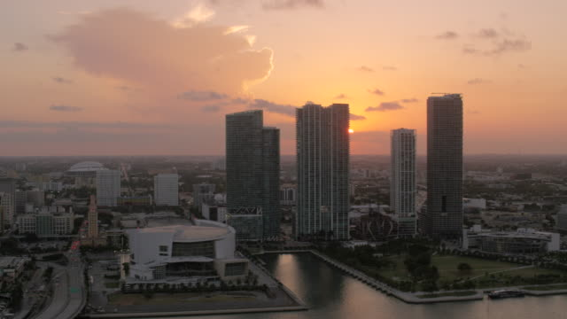 aerial of buildings in downtown miami at sunset florida - macarthur causeway bridge stock videos and b-roll footage