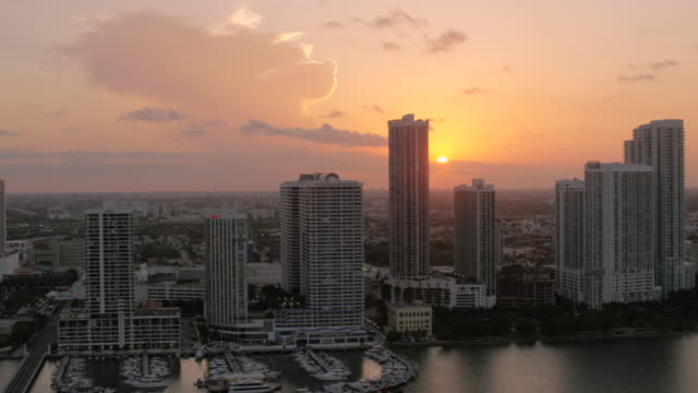aerial of buildings in downtown miami at sunset florida - miami dade county stock videos and b-roll footage
