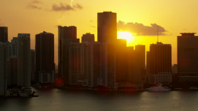 aerial of buildings in downtown miami at sunset - マイアミ点の映像素材/bロール