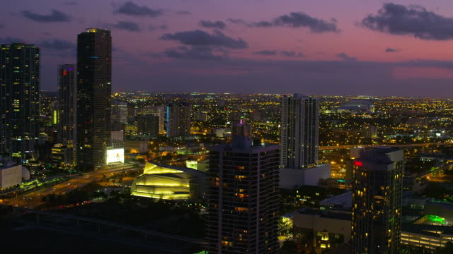 aerial of buildings in downtown miami at sunset - miami dade county stock videos and b-roll footage