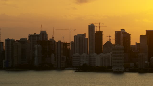 Aerial of buildings in downtown Miami beautiful color sky FL