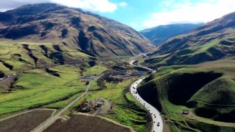 aerial of california grapevine and interstate 5 freeway farmland - californian sierra nevada stock videos & royalty-free footage