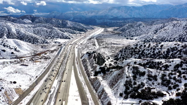 aerial of california grapevine and interstate 5 freeway in snow - californian sierra nevada stock videos & royalty-free footage