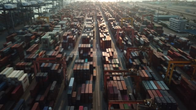 aerial of cargo container and docks at sunset - docks stock videos & royalty-free footage