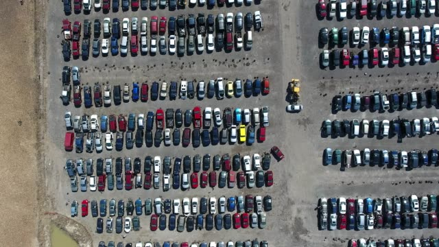 aerial of cars being recycled in junk yard - altmetall stock-videos und b-roll-filmmaterial