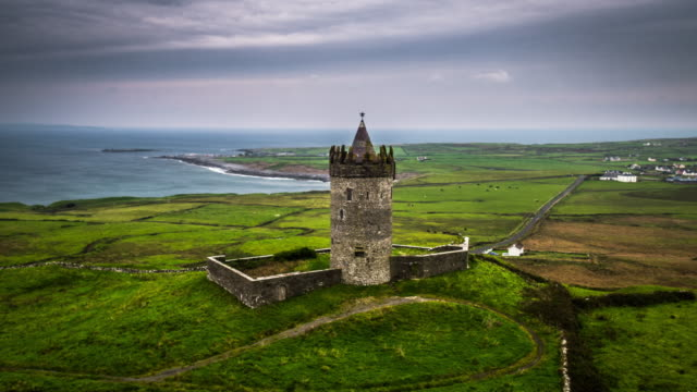aerial of castle in idyllic landscape in ireland - doolin stock videos & royalty-free footage