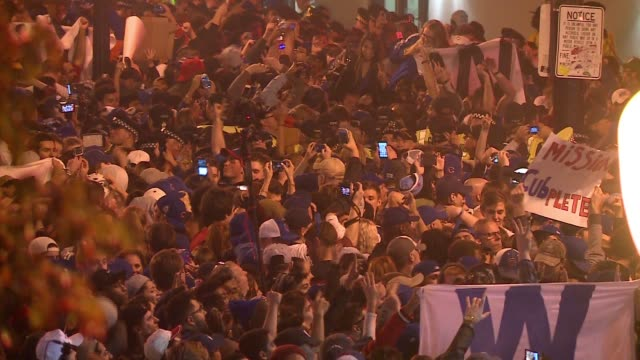 WGN Aerial of Chicago Cubs Fans Cheering outside Wrigley Field as the Cubs Win the World Series on Nov 2 2016