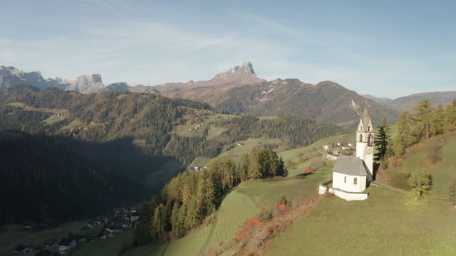 aerial of chiesa di santa barbara in lunz in the italian dolomites, italy. - chapel stock videos & royalty-free footage
