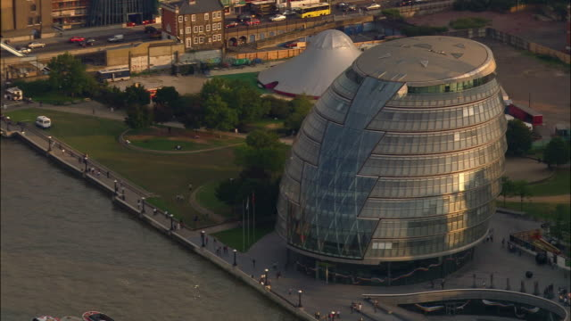 aerial of city hall on bank of thames / london - town hall stock videos & royalty-free footage