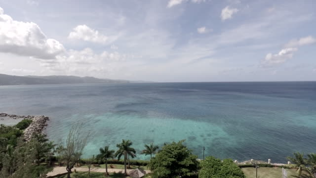 aerial of clear blue waters in montego bay jamaica - jamaica stock videos & royalty-free footage