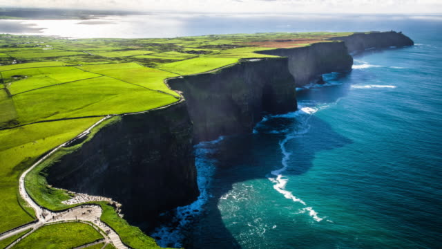 aerial of cliffs of moher, burren region, county clare, ireland - doolin stock videos & royalty-free footage