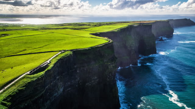 aerial of cliffs of moher in ireland - coastal feature stock videos & royalty-free footage
