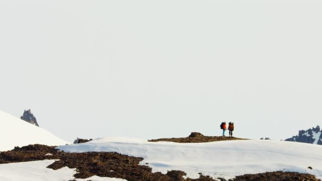 Aerial of climbing team on Alaska mountain snow