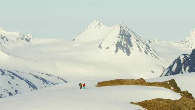 Aerial of climbing team on Alaska mountain snow