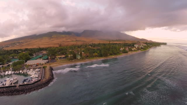 aerial of coast, mountains, and rippling ocean in maui, hi - maui stock videos & royalty-free footage
