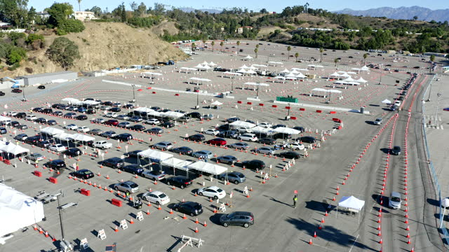 aerial of covid-19 vaccine distribution in parking lot - parking stock videos & royalty-free footage