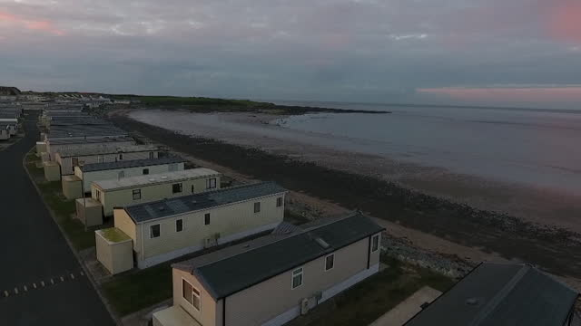 aerial of cranfield caravan site in newry, northern ireland, an example of self contained holiday accommodation that people can use during... - trapped stock videos & royalty-free footage