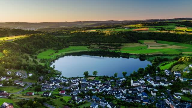 Aerial of crater lake Schalkenmehrener Maar in Germany