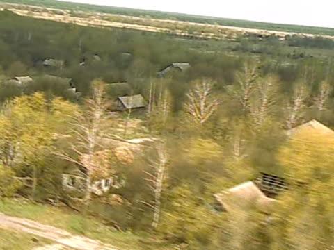 aerial of derelict village in chernobyl alienation zone - anno 1986 video stock e b–roll