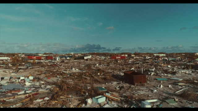 aerial of destruction and devastation of town obliterated by hurricane dorian in marsh harbour on the abaco islands bahamas - zerstörung stock-videos und b-roll-filmmaterial