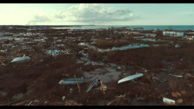 aerial of devastation and destruction of town obliterated by hurricane dorian in marsh harbour on the abaco islands, bahamas - バハマ点の映像素材/bロール