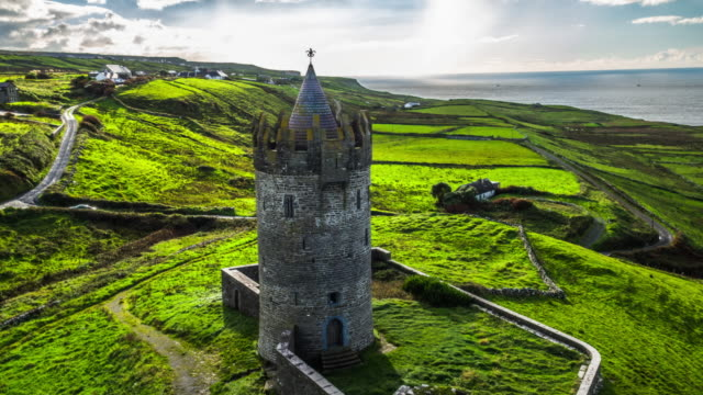 aerial of doonagore castle in ireland - tower stock videos & royalty-free footage
