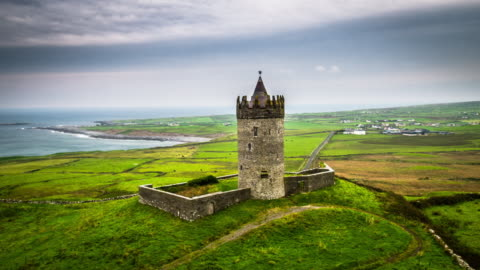 aerial of doonagore castle in ireland - castle stock videos & royalty-free footage