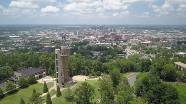 aerial of downtown birmingham and vulcan statue - birmingham alabama video stock e b–roll