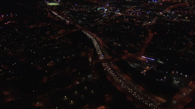 Aerial of downtown Los Angeles. 110 freeway or highway, traffic. city and urban area.