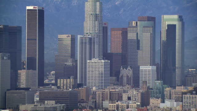 Aerial of Downtown Los Angeles and Santa Monica Mountains, zooming out.