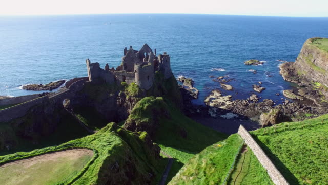aerial of dunluce castle / county antrim, northern ireland - 北アイルランド点の映像素材/bロール