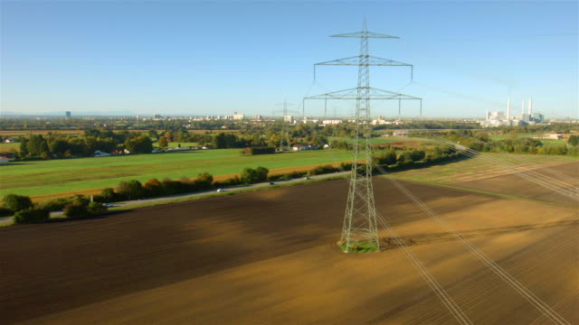 ws aerial of electric power lines and utility poles - stromleitung stock-videos und b-roll-filmmaterial