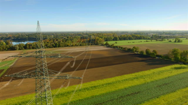 cu aerial of electric power lines and utility poles - stromleitung stock-videos und b-roll-filmmaterial