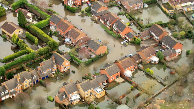 aerial of environmental damage by flooding surrey uk - surrey england stock videos & royalty-free footage