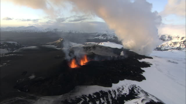 Aerial of erupting volcano, evening, lava bright orange, Eyjafjallajokull, Iceland, April 2010