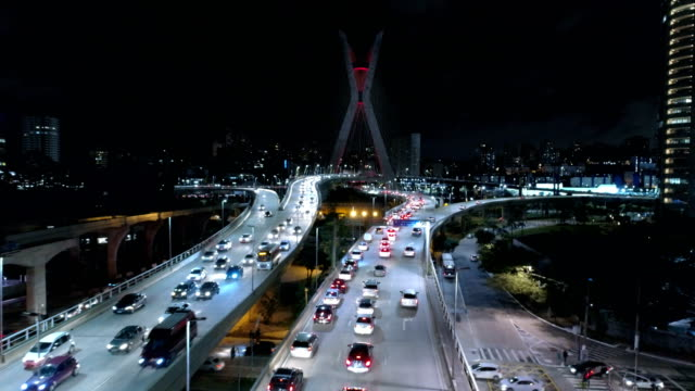 aerial of estaiada bridge at night - cable stayed bridge stock videos & royalty-free footage