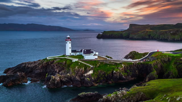 aerial of fanad head lighthouse in ireland - lighthouse stock videos & royalty-free footage