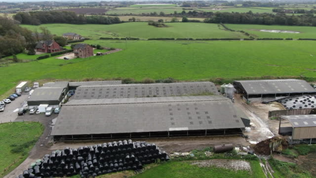 aerial of farm surrounded by fields in lancashire where shale gas lies beneath making it an ideal site for fracking - land stock videos & royalty-free footage