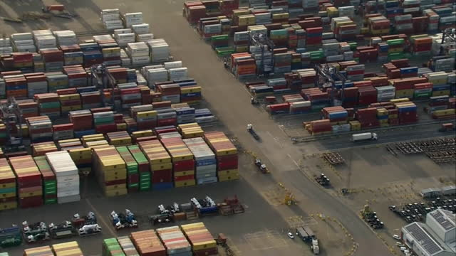 aerial of felixstowe port with shipping containers stacking up due to disruption to gloabal supply chains caused by coronavirus pandemic and brexit... - cargo container stock videos & royalty-free footage