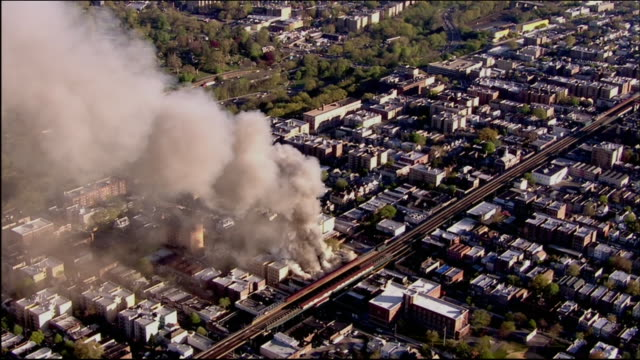 aerial of five-alarm fire in bronx - produced segment stock videos & royalty-free footage