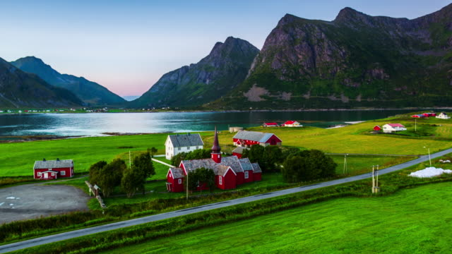 Aerial of fjord with idyllic village, Lofoten Islands, Norway