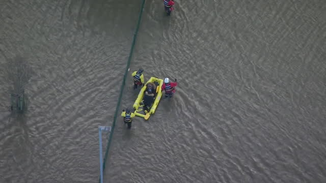 aerial of flooding in warrington due to heavy rain caused by storm christoph - weather stock videos & royalty-free footage