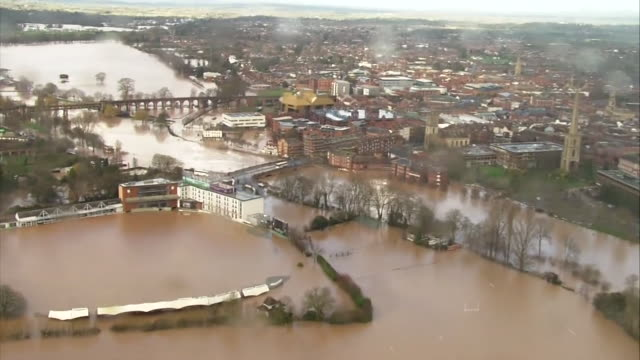 aerial of flooding in worcester after the severn burst it's banks due to rain during storm dennis - storm stock videos & royalty-free footage