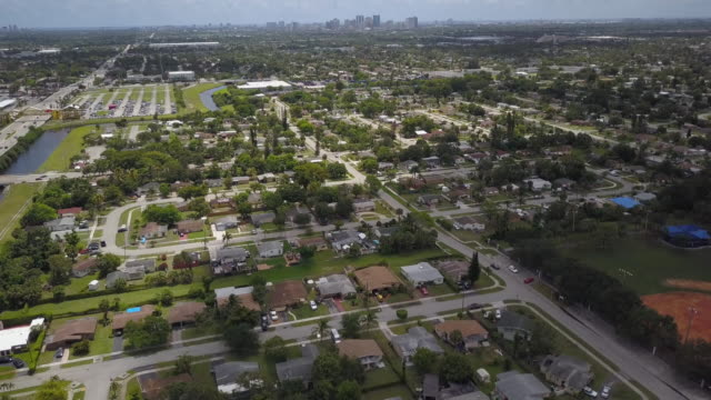 aerial of florida suburb, tilt down - florida usa stock videos and b-roll footage