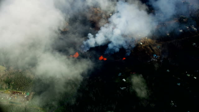 aerial of flowing volcanic magma destroying property kilauea - sulphur stock videos & royalty-free footage