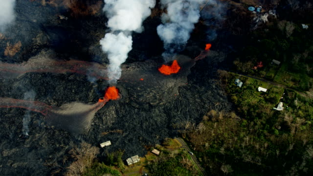 aerial of flowing volcanic magma destroying property kilauea - volcano stock videos & royalty-free footage