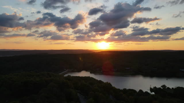 aerial of forest at sunset, 4k nature/wildlife/weather, aerial ecological forest sunset beautiful shot. ideal background for forest conservation, save biology and nature, ecology theme, aerial sunset background, lake sunset - wildlife conservation stock videos & royalty-free footage