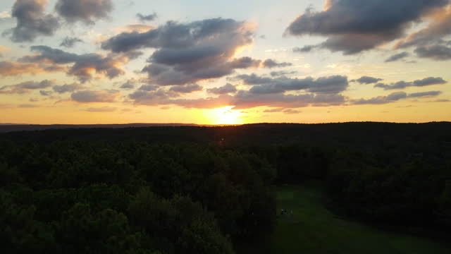 aerial of forest at sunset, 4k nature/wildlife/weather, aerial ecological forest sunset beautiful shot. ideal background for forest conservation, save biology and nature, ecology theme, global warming and forest fire theme, aerial view of golf course - wildlife conservation stock videos & royalty-free footage